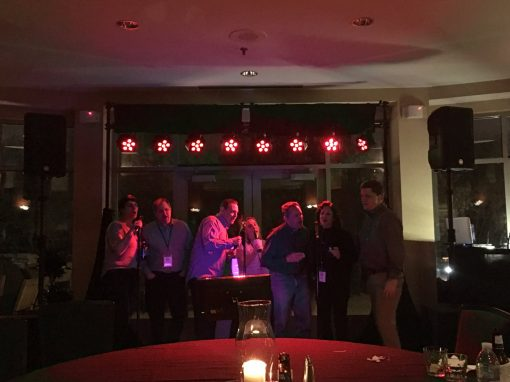 People having fun at a party singing karaoke with microphones